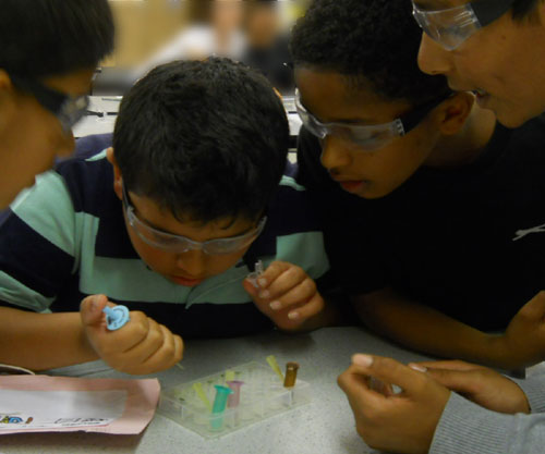 Students complete the Thinkers in Education ELISA workshop during a school transition day from KS2 to KS3
